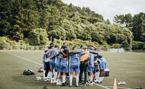 Wellington Lautoka FC huddle up ahead of their first group match in the 2021 Wellington B.O.G. tournament. March 2021