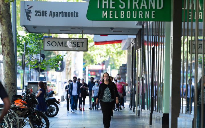 People are seen walking along Elizabeth Streeth on February 18, 2021 in Melbourne, Australia.