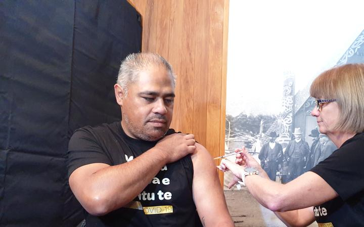 Associate Health Minister Peeni Henare receives a Covid-19 vaccine, Porirua, 7 April 2021.