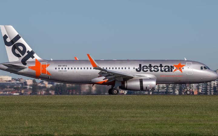 Sydney, Australia - May 5, 2014: Jetstar Airways Airbus A320 airliner landing at Sydney Airport.