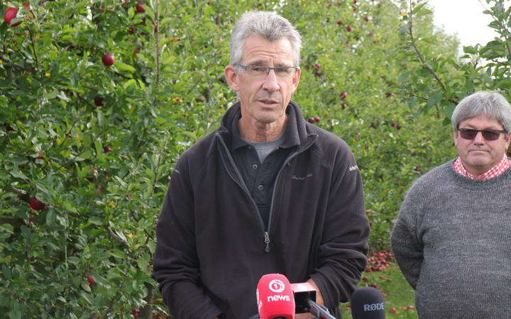 Bruce Mitchell says there just aren't enough workers to harvest his apples for export.