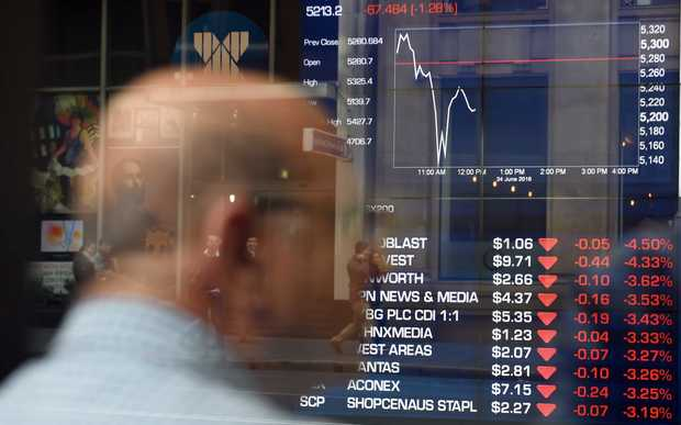 man monitors trading at a stock exchange in Sydney on June 24, 2016.