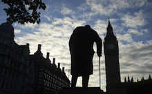 A statue of Winston Churchill is silhouetted by Big Ben and the Houses of Parliament in central London on the morning the Brexit results were announced.