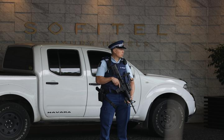 An armed police officer at the Sofitel in Viaduct Basin, Auckland.