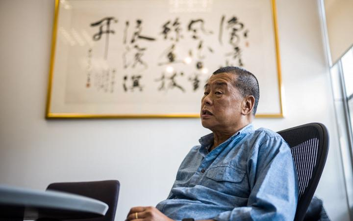 (FILES) In this file photo taken on June 16, 2020, millionaire media tycoon Jimmy Lai, 72, speaks during an interview with AFP at the Next Digital offices in Hong Kong.