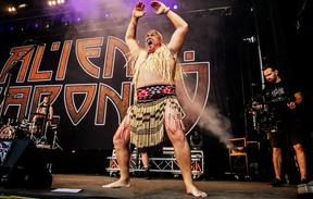 Kane Harnett-Mutu performing a haka before a performance by New Zealand band Alien Weaponry at a heavy metal festival in Denmark.