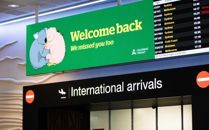 Auckland Airport welcome back sign.