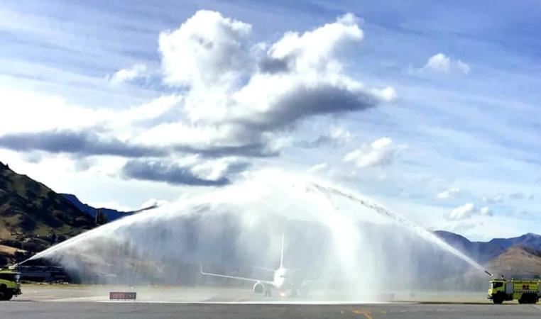 The first quarantine-free flight into Queenstown goes through the water arch - a salute to welcome the special visitors