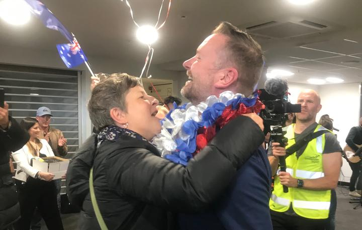 An emotional reunion as loved ones greet each other at Queenstown Airport