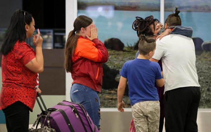 Loved ones embrace at Christchurch Airport