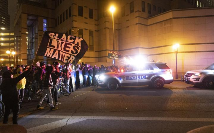 Black Lives Matter activists confront Columbus Police outside of Columbus Police headquarters during a protest in reaction to the shooting of Makiyah Bryant.