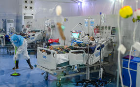 A doctor cleaning the floor of the intensive care unit at the Covid Center at the Thuwana football stadium in Yangon, Myanmar, on 1 January, 2021.