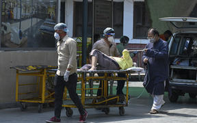 A Covid-19 patient arrives at the GTB hospital in New Delhi on 29 April 2021.