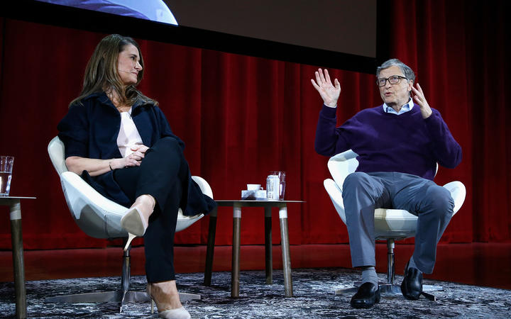 (FILES) In this file photo taken on February 13, 2018 Melinda Gates and Bill Gates speak during the Lin-Manuel Miranda In conversation with Bill & Melinda Gates panel at Hunter College in New York City. -