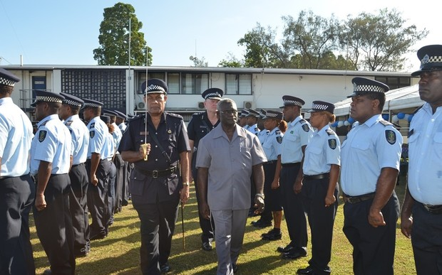 Solomon Islands Prime Minister Manasseh Sogavare inspects a guard of honour by members of the RSIPF before the opening of the National Response Department facility.