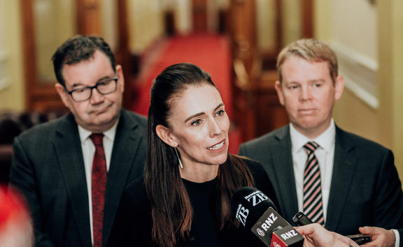 Jacinda Ardern flanked by Grant Robertson, left, and Chris Hipkins, right.