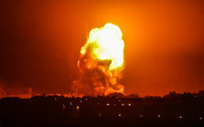 Fire billows from Israeli air strikes in Rafah, in the southern Gaza Strip, on May 11, 2021.