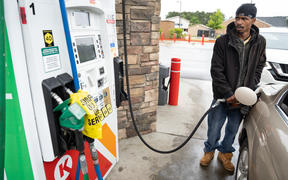 Tavon Clodfelter watches the petrol pump anxiously in Fayetteville, North Carolina, on 12 May. Most stations in the area along  have been without fuel following the hack of the Colonial Pipeline.
