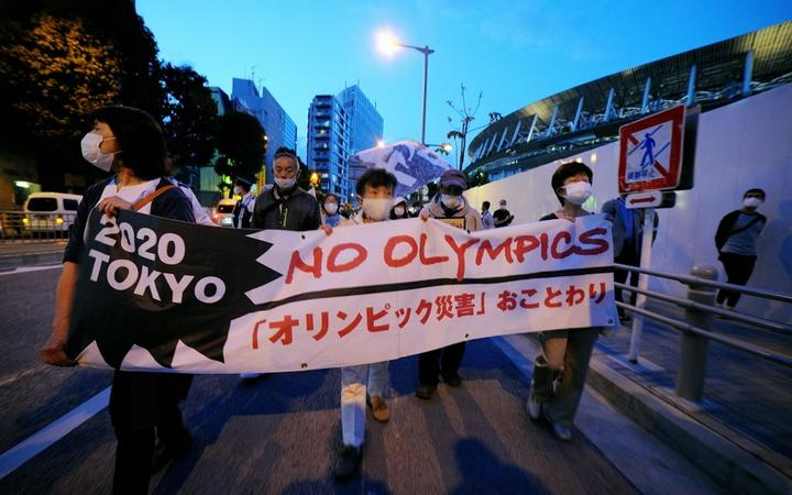 TOKYO, JAPAN - MAY 09: People stage a demonstration as they demand Tokyo Olympics to cancelled due to coronavirus pandemic in Tokyo, Japan on May 9, 2021.