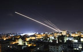 Rockets are launched from Gaza City, controlled by the Palestinian Hamas movement, towards Israel early on May 15, 2021.