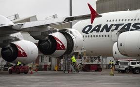 This picture taken on June 1, 2018 shows ground staff preparing a Qantas Airbus A380 aircraft for flight at the Sydney International airport.