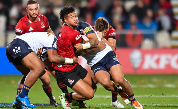 Leicester Faingaanuku of the Crusaders is tackled by Len Ikitau of the Brumbies and Solomone Kata of the Brumbies during the Sky Super Rugby Trans-Tasman match, Crusaders V Brumbies, at Orangetheory Stadium, Christchurch, New Zealand, 15th May 2021.
