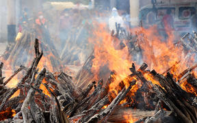 India's second Covid-19 wave has had a devastating human toll. Funeral pyres in New Delhi.