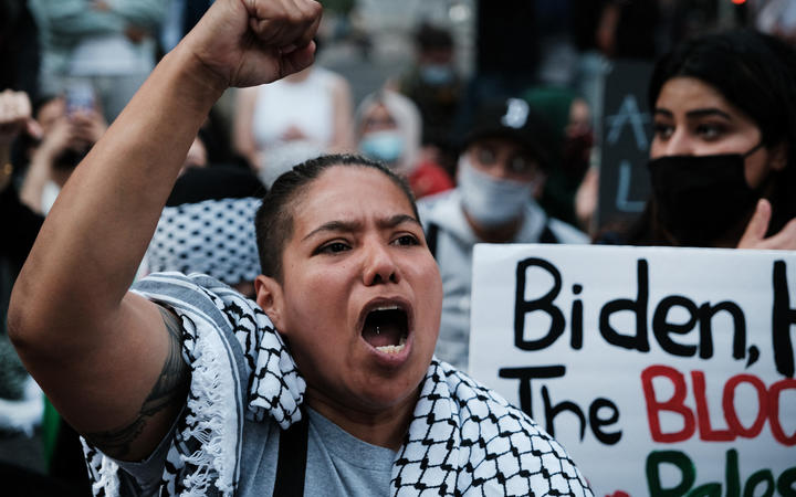Thousands of protesters and activists shut down a street as they voice anger at Israel and support of Palestinians in New York City.