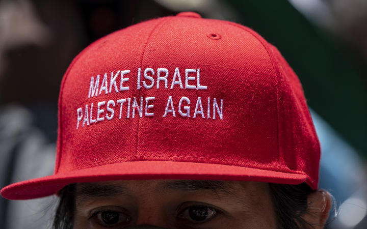 Thousands gather in front of the Consulate General of Israel in Los Angeles, CA to protest in solidarity with Palestinians on strike in Israel, the West Bank, and the Gaza Strip.