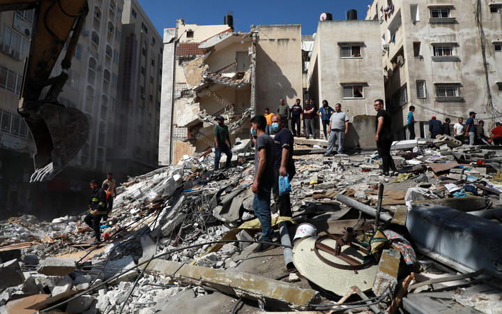 Palestinians inspect a destroyed house, after it was struck by Israeli strikes, in Gaza City this week.