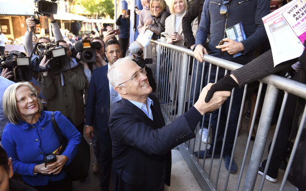 Malcolm Turnbull and his wife Lucy leave a polling station after casting their vote in Sydney.