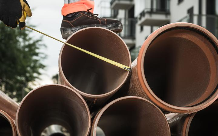 Large Sanitary Pipeline Installation. Construction Industry Theme. Foul Sewer.