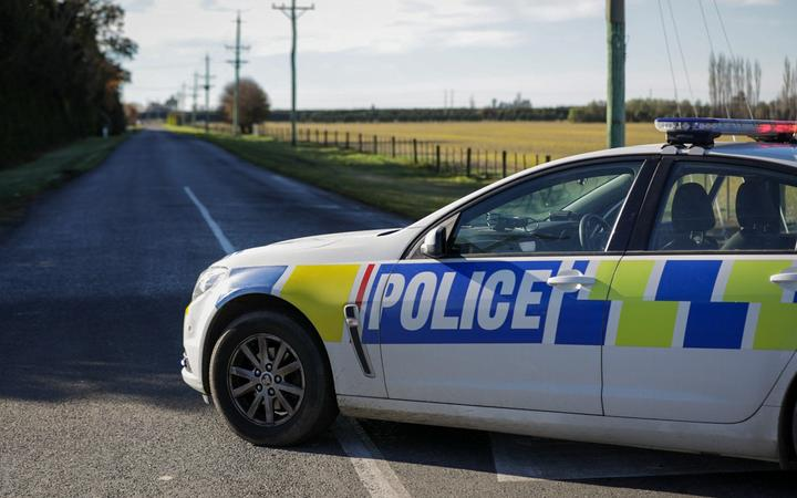 The scene of a crash where four people died after a truck and van collided near Ashburton.