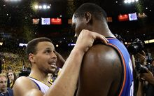 Golden State's MVP Steph Curry speaks with Kevin Durant after the Warriors' 96-88 win in Game Seven of the Western Conference Finals during the 2016 NBA Playoffs in Oakland. Ezra Shaw/Getty Images/AFP EZRA SHAW / GETTY IMAGES NORTH AMERICA / AFP
