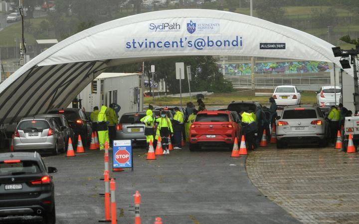 Medical officers conduct a mass Covid-19 testing at a parking lot on Bondi Beach in Sydney on May 6, 2021,