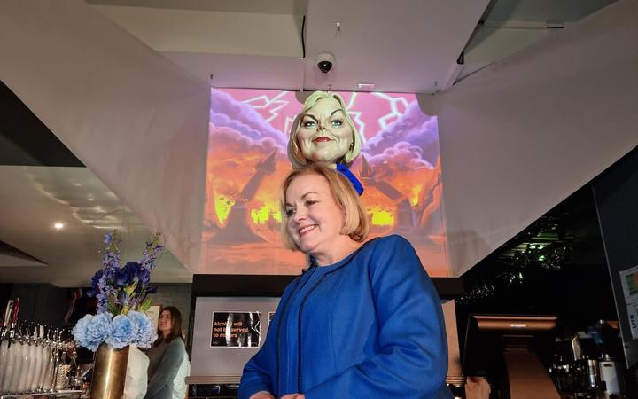National leader Judith Collins with puppet caricature at Wellington's Backbencher pub.