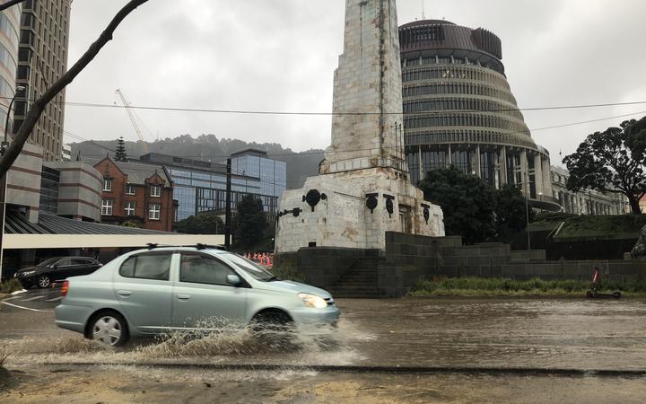 A car drives through water in Wellington