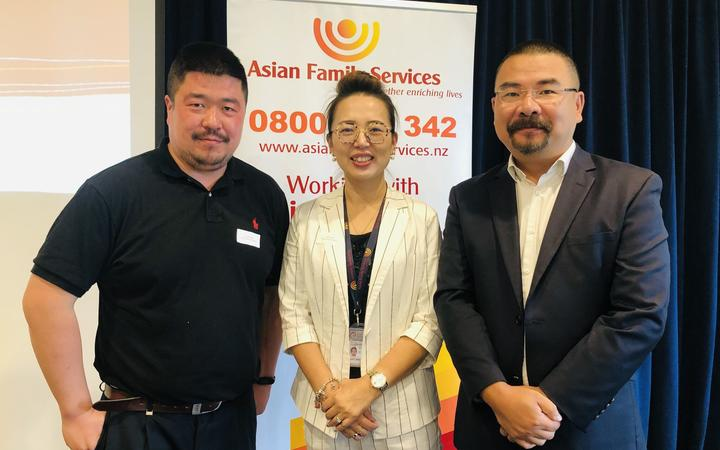 Bo Ning (left) and Kelly Feng from Asian Family Services and Dr Andrew Zhu (right) of Trace Research.