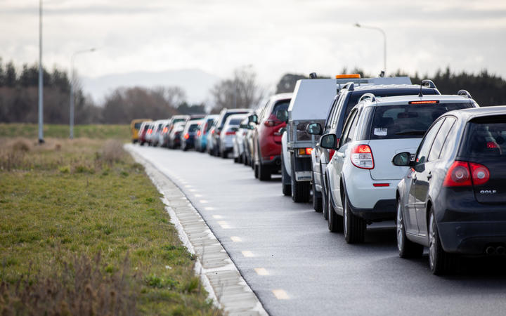 Cars line up as people wait to be tested for Covid-19 at the Orchard Road drive-through testing centre in Christchurch