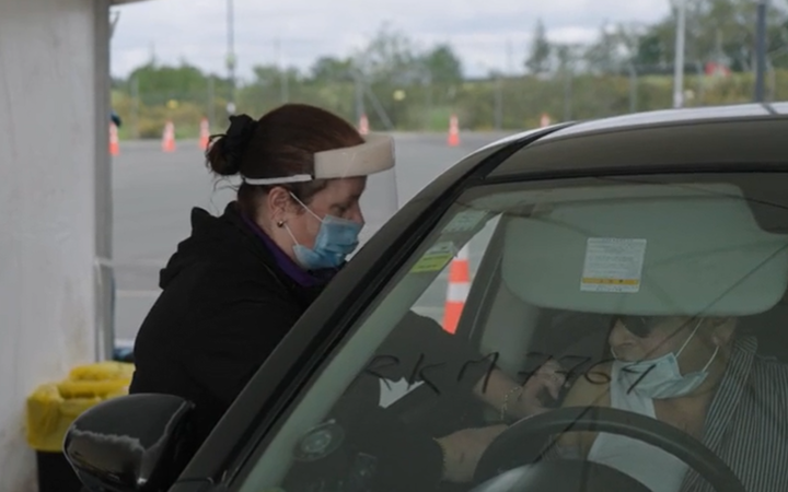 A driver is vaccinated on the first day of the country's largest drive-through vaccination centre at the Park and Ride at Auckland Airport
