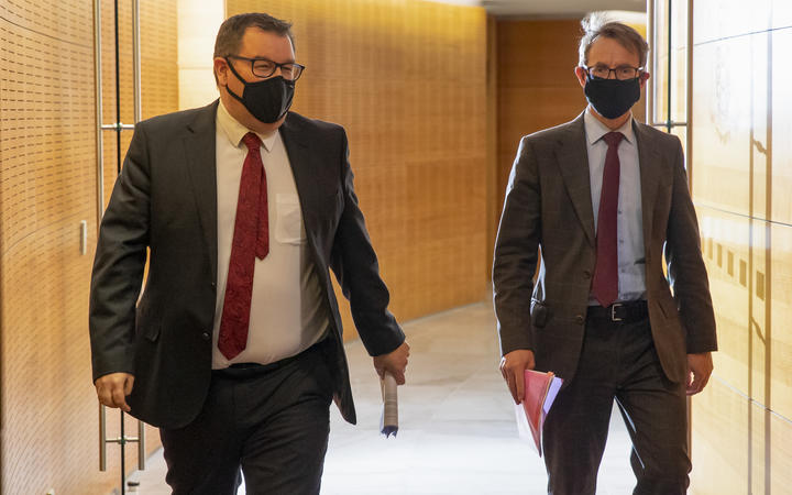 Deputy Prime Minister Grant Robertson and Director General of Health Dr Ashley Bloomfield arriving for the Covid-19 response and vaccine update at Parliament, Wellington.  24 August, 2021  NZ Herald photograph by Mark Mitchell