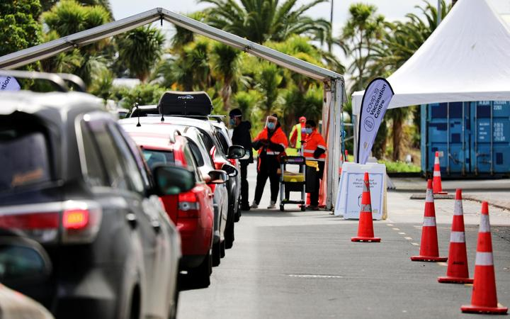 People waiting for their turn at the drive-through vaccination centre at The Trusts Arena, Auckland.