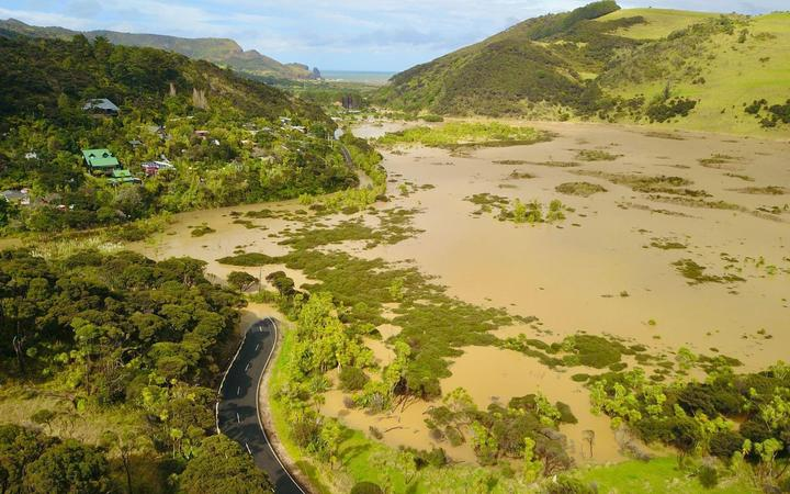 Residents of Te Henga Bethells Beach have no access to the only road out of the area after flooding in the area.