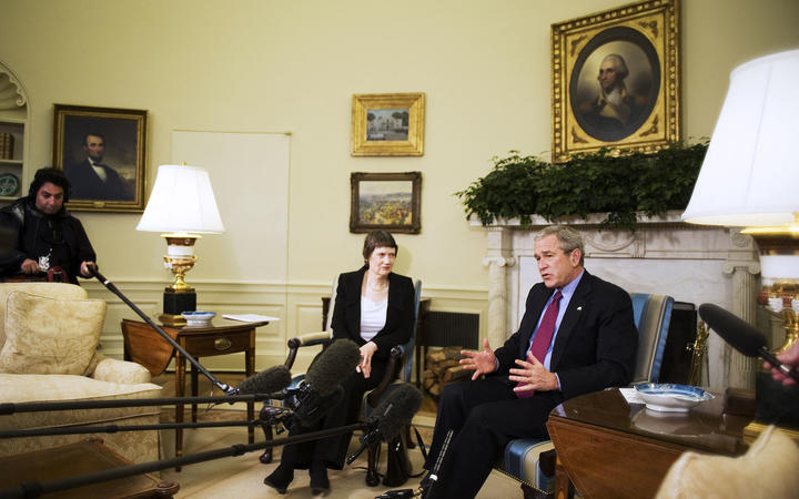 US President George W. Bush (R) speaks to the press during a meeting with New Zealand Prime Minister Helen Clark 21 March 2007 in the Oval Office.