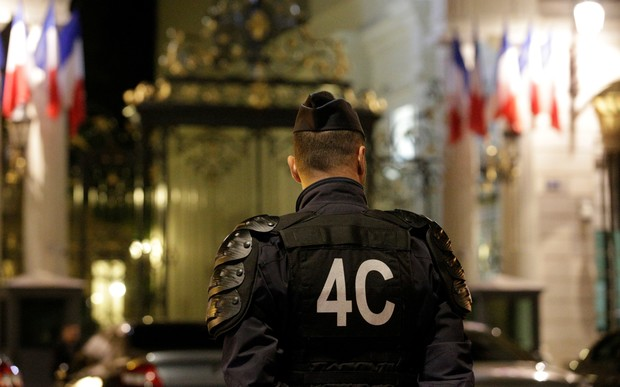 Police officers stand outside the French Interior Ministry in Paris on 15 July 2016.