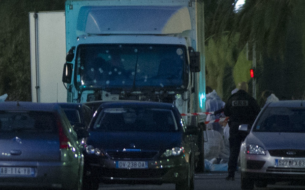 A truck with its windscreen riddled with bullets is seen on a street on July 15, 2016, after it ploughed into a crowd leaving a fireworks display in the French Riviera town of Nice.
