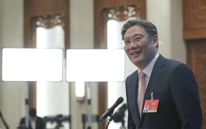 Chinese Minister of Commerce Wang Wentao prepares to leave after giving an interview via video link following the second plenary meeting of the fourth session of the 13th National People's Congress (NPC) in Beijing, capital of China, March 8, 2021.
