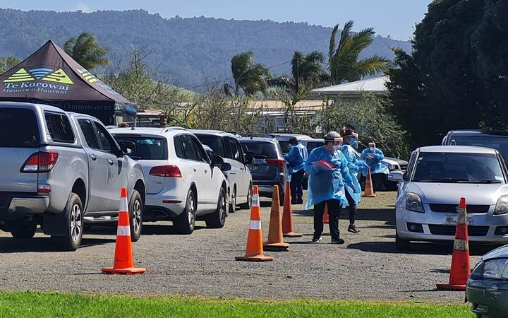 A steady flow of people have been going through a testing centre near Kaiaua on the Firth of Thames following the discovery of three Covid-19 cases in the area, outside the level 4 boundary.