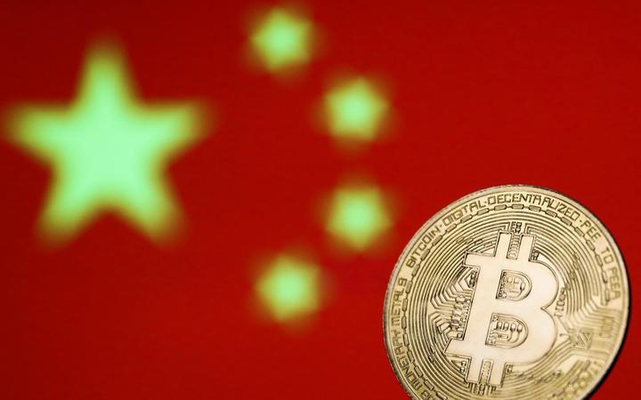 China's top regulators ban crypto trading and mining, sending bitcoin tumbling - RNZ