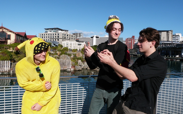 Campbell Beecroft, Charlie Jones and James Tweddell join about 1000 people to play Pokemon Go in Wellington.